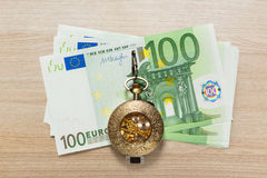 Euro banknotes and vintage pocket watch Stock Images
