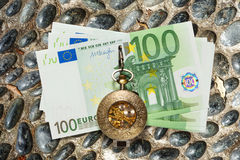 Euro banknotes and vintage pocket watch Royalty Free Stock Photo