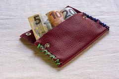 Euro banknotes in a wallet. 5, 10 and 20 Euro banknotes in an open purse or wallet protruding from the top showing the various denominations Stock Image