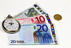 Euro banknotes and watch Royalty Free Stock Photos