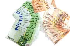100 and 50 Euro banknotes on a white background royalty free stock images