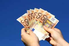 Euro banknotes in woman hand Stock Photos