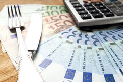 Euro banknotes on a wooden board with Cutlery Royalty Free Stock Photography