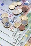 Euro banknoty i monety zdjęcia stock