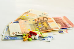 Euro banknoty i pigułki obrazy royalty free