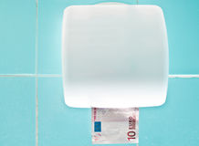 Euro bathroom. Old euro, used like a toilet paper Royalty Free Stock Images