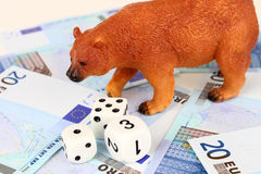Euro Bear Market. A bear playing dice with Euro money Stock Photo