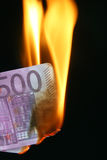 Euro bill on fire Royalty Free Stock Image