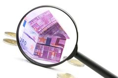 Euro bill House and expenses under magnifying glass Royalty Free Stock Images