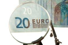 Euro bill thru magnifying glass Stock Image