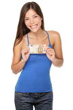 Euro bill woman. Smiling happy showing 50 euro money note isolated on white background. Beautiful fresh young mixed race Asian / Caucasian girl in her twenties Stock Photo