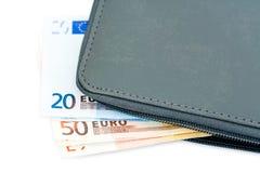Euro billets de banque dans la pochette photo stock