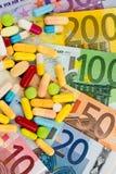 Euro billets de banque et comprimés Photo libre de droits