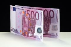 500 euro billets de banque et euro pièces de monnaie Images libres de droits