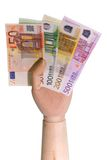 Euro Bills. Wooden hand holding Euro bills on white background royalty free stock photo
