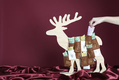 Euro bills in an advent calendar. Euro bills are taken out of an advent calendar Stock Photo