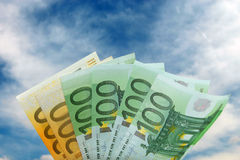 Euro bills against blue skies Stock Image