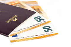 100 euro bills banknotes inserted between pages of european French passport Royalty Free Stock Photo