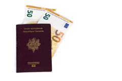 100 euro bills banknotes inserted between pages of european French passport. Concept price travel, backchich. Front and top view, close-up Royalty Free Stock Photos