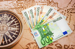 Euro bills on the big map. Euro bills close-up on the Europe map royalty free stock image