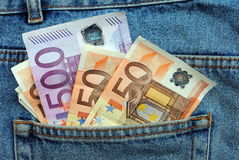 Euro bills in a blue jeans pocket. Concept of money and business Royalty Free Stock Image