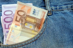 Euro bills in a blue jeans pocket Royalty Free Stock Photos