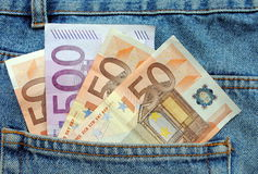 Euro bills in a blue jeans pocket Royalty Free Stock Images