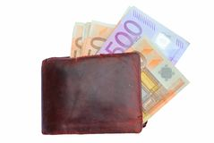Euro bills in a brown wallet isolated. On white background Royalty Free Stock Photography