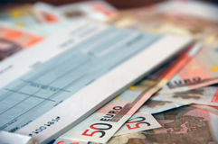Euro bills and cheque. Cheque over lots of euro bills; ideal for backgrounds Stock Photos