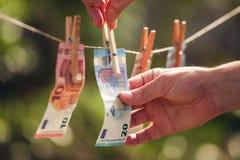 Euro bills on clothesline Stock Photo