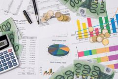 Euro bills and coin with busines chart and pen. Business concept Royalty Free Stock Photography