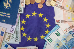 Euro bills with coin, passport Royalty Free Stock Photos