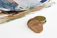 Euro Bills and Coins. Stack of Euro Banknotes and Coins royalty free stock photo