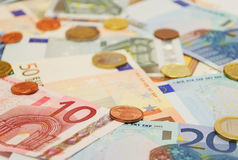 Euro bills and coins. Euro coins and bills with selective focus Royalty Free Stock Photography