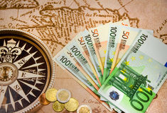 Euro bills with coins on the big map. Euro bills close-up on the Europe map stock image