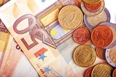 Euro Bills and Coins Stock Photography
