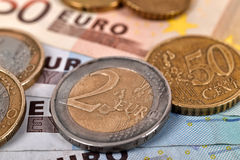 Euro Bills and Coins Stock Image