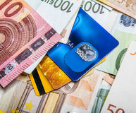 Euro bills and credit card background. Stock Images