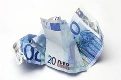 Euro bills crumpled. Two twenty Euro bills crumpled on light background Stock Image