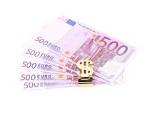 Euro bills and dollar gold trinket. Royalty Free Stock Photo