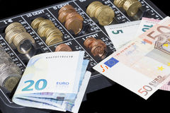 Euro bills and euro coins organizer Stock Images