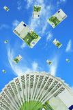Euro bills falling in the sky Stock Photo