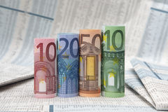 Euro bills on financial newspaper Royalty Free Stock Photos