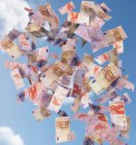 Euro bills flying in the sky Stock Images