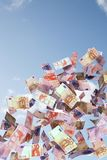 Euro bills flying in the sky Royalty Free Stock Images