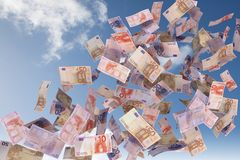 Euro bills flying in the sky Stock Photo