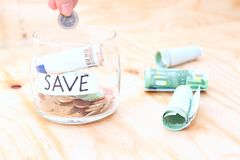 Euro bills in glass jar on wooden table. Saving money concept. Royalty Free Stock Photography