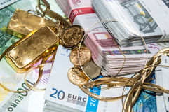 Euro Bills and Gold. (bullions and jewellery Stock Photos