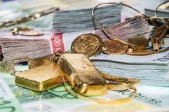 Euro Bills and Gold Stock Photos