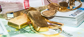 Euro Bills and Gold. (bullions and jewellery Royalty Free Stock Photography